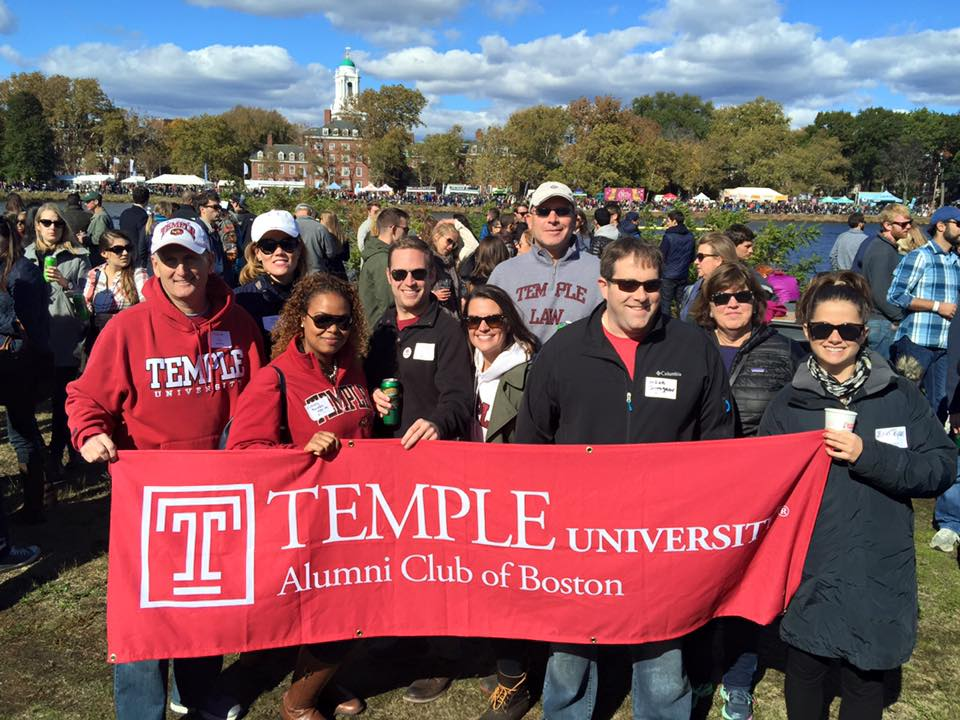 Boston Chapter of the TUAA holding the Temple banner.
